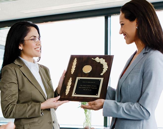 award-executives-applauding-two-women